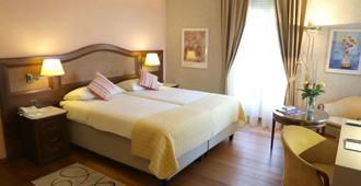 贝勒维悠乐最佳西方酒店 - 卢加诺 - 睡房