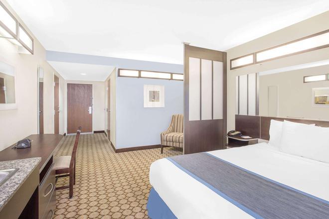 圣安吉洛麦克罗特套房酒店 - 圣安吉洛 - 睡房