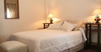 阿里奥斯托酒店 - 门多萨 - 睡房