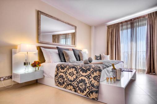 艾克斯宫廷酒店 - 斯利马 - 睡房