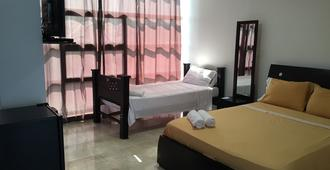 中央海滩旅馆 - 圣安德列斯 - 睡房