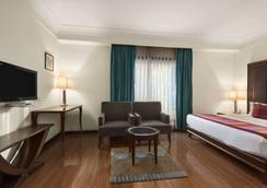 贾朗达尔市中心华美达酒店 - 賈朗達爾 - 睡房
