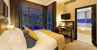 阿尔曼泽尔公寓酒店 - 阿布扎比 - 睡房