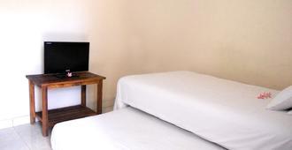 巴厘岛自然寄宿旅馆 - South Kuta - 睡房