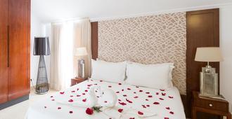 木图奥拉海滩俱乐部观景大酒店 - 阿尔布费拉 - 睡房