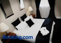 卡斯特姆斯住宿加早餐旅馆 - 干比尔山 - 睡房
