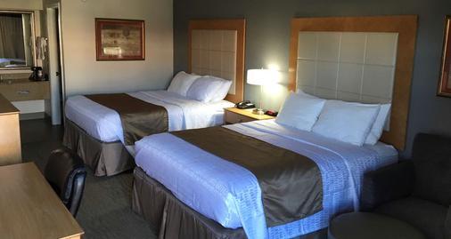 贝斯特韦斯特机场汽车旅馆 - 珍珠城 - 睡房