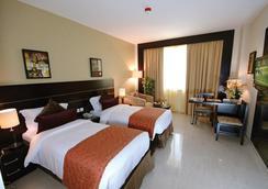 里卡地标酒店 - 迪拜 - 睡房