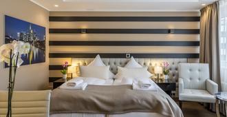 美因河畔法兰克福天际酒店 - 法兰克福 - 睡房