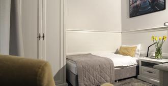 诺莫夫卢比扬卡公寓式酒店 - 莫斯科 - 睡房