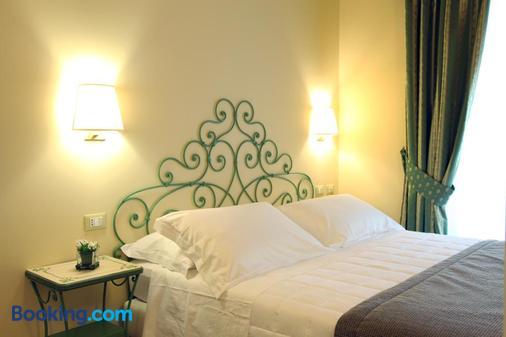 焉提博古酒店 - 科摩 - 睡房