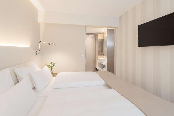 汉堡米特nh酒店 - 汉堡 - 睡房