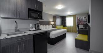 乐多芬魁北克套房和酒店 - 魁北克市 - 睡房