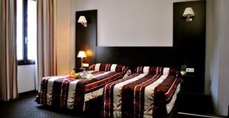 联盟酒店 - 卢尔德 - 睡房