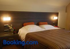 鲁宾斯酒店 - 德哈恩 - 睡房