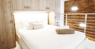 波尔泰洛阿莱西亚公寓 - 米兰 - 睡房