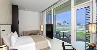 阿尔左拉的欧贝罗伊海滩度假酒店 - 阿治曼 - 睡房