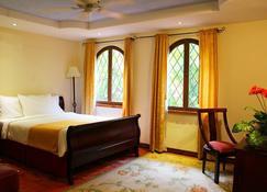 卡萨普里莫cr酒店 - 圣荷西 - 睡房