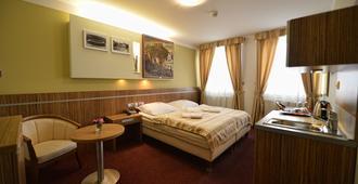 瓦卡酒店 - 布尔诺 - 睡房