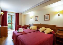 坎加斯奥尼斯城酒店 - 坎加斯-德奥尼斯 - 睡房