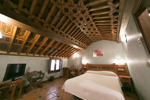 波萨达德尔托洛酒店 - 格拉纳达 - 睡房