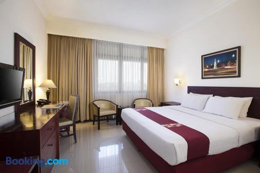 木格姆酒店 - 日惹 - 睡房