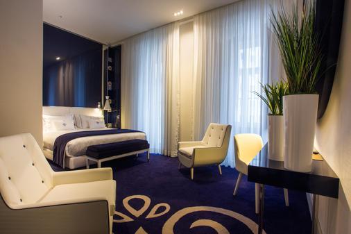 葡萄牙精品酒店 - 里斯本 - 睡房