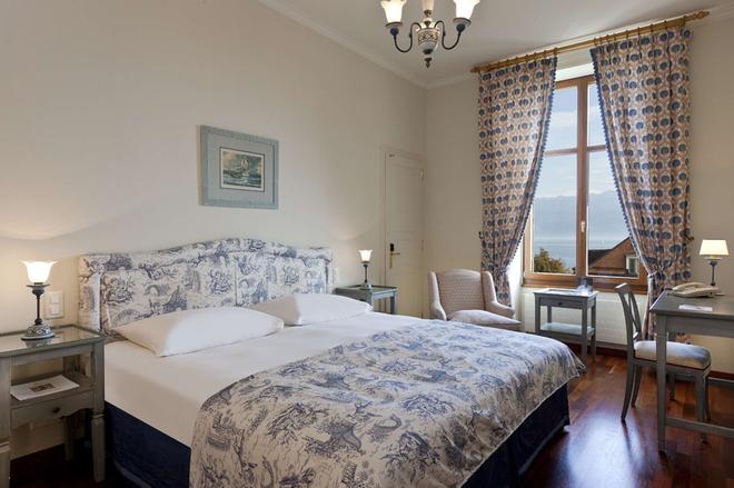 英格兰旅馆和公寓 - 洛桑 - 睡房