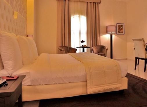 Il Palazzo Hotel & Suites - 安曼 - 睡房