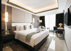 安巴卢莫大酒店 - 日惹 - 睡房