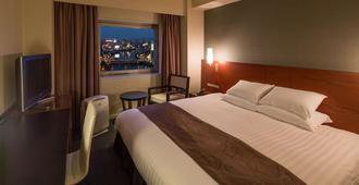 博多秀雅东急酒店 - 福冈 - 睡房