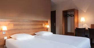 科尔马车站原创访问酒店(小德尔酒店) - 科尔马 - 睡房