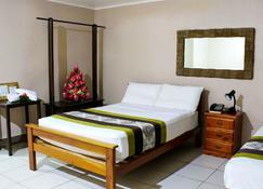 阿皮亚中心萨摩亚酒店 - 阿皮亚 - 睡房