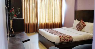 孟买卡姆兰居留酒店 - 孟买 - 睡房