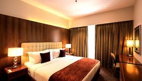 班加罗尔奥克伍德高级威望酒店 - 班加罗尔 - 睡房