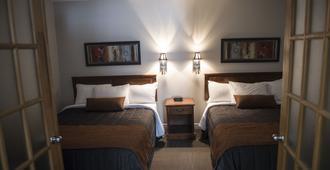 乐多维尔汽车旅馆 - 三河市 - 睡房
