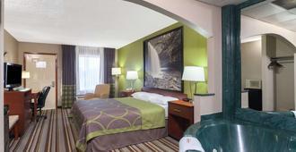 克拉克斯维尔东北速8酒店 - 克拉克斯维尔 - 睡房