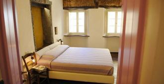潘埃维诺洛坎达酒店 - 哥尔顿 - 睡房