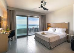 奥斯特海滨酒店 - 卡尼奥蒂斯 - 睡房