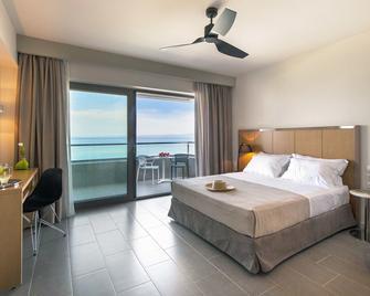 奥斯特里亚海滨酒店 - 卡尼奥蒂斯 - 睡房