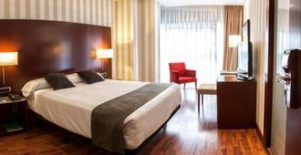 泽尼特拉科鲁尼亚酒店 - 拉科鲁尼亚 - 睡房