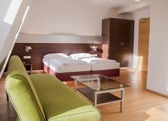 施瓦茨巴尔酒店 - 林茨 - 睡房
