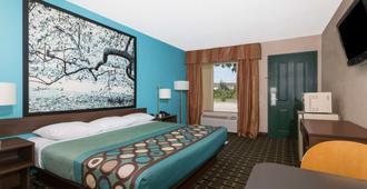 南不伦瑞克速8汽车旅馆 - 布伦瑞克 - 睡房