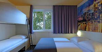 法兰克福市东部床和早餐酒店 - 法兰克福 - 睡房