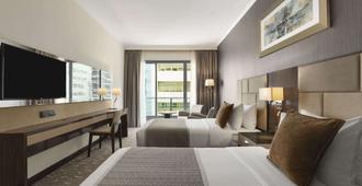 阿布扎比市中心温德姆豪顿套房酒店 - 阿布扎比 - 睡房