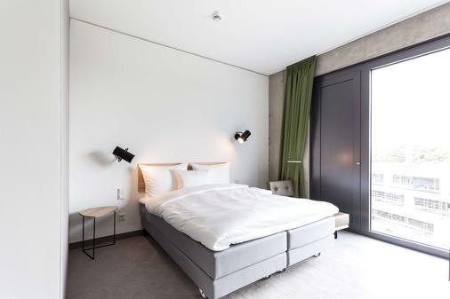茨恩茨恩纳蒂甘比诺酒店 - 慕尼黑 - 睡房