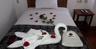 佩鲁曼塔家庭旅馆 - 马丘比丘 - 睡房