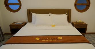 巴厘岛阿卡那卡佩特坦盖酒店 - 库塔 - 睡房