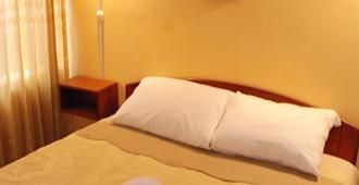 Huchuy Wasi Hostel - 普诺 - 睡房