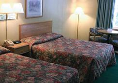 布兰森四季汽车旅馆 - 布兰森 - 睡房